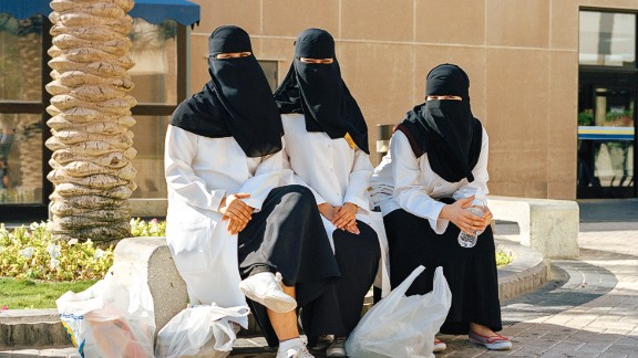 Nurses from Dhahran Health Center waiting for a bus outside the commissary.