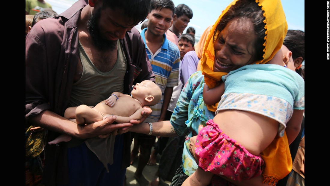 "Rohingya refugees fleeing Myanmar hold their infant son Abdul Masood, <a href=""http://www.cnn.com/2017/09/14/asia/myanmar-rohingya-muslim-family-mourns-infant-son/index.html"" target=""_blank"">who died when their boat capsized</a> before reaching Bangladesh on September 13."