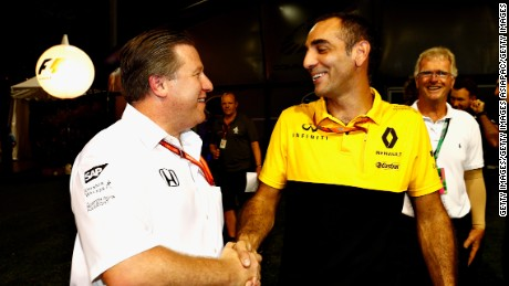 McLaren team boss Zak Brown (left) shakes hands with Renault Sport F1 managing director Cyril Abiteboul in Singapore following the announcement of the engine deal.