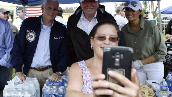 First lady Melania Trump poses for a selfie with her husband, President Trump, as they help serve food to people affected by Hurricane Irma, in Naples, Florida, on September 14, 2017.