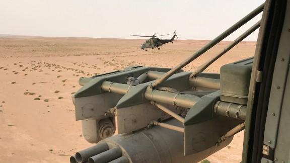 Russian military helicopters race across the eastern Syrian desert towards Deir Ezzor.