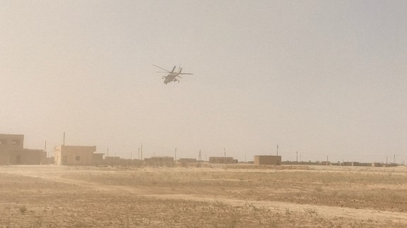 A Russian combat helicopter flies over Deir Ezzor, where there has been intense fighting against ISIS.