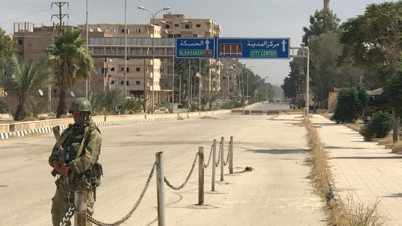 A soldier patrols on a street in Deir Ezzor in eastern Syria.