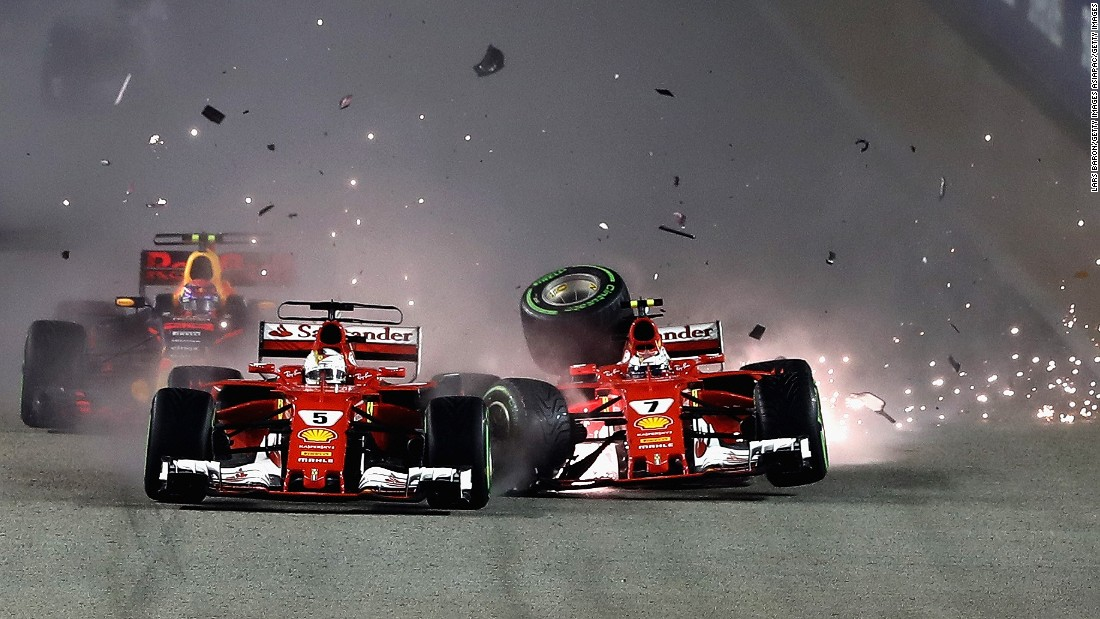 Sparks fly as Ferrari's Sebastian Vettel (left) and Kimi Raikkonen clash at the start of the Singapore Grand Prix.