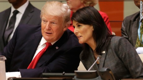 President Donald Trump speaks with US Ambassador to the United Nations Nikki Haley before a meeting during the UN General Assembly. (AP Photo/Seth Wenig)