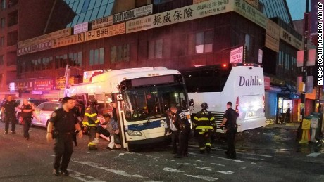 NYPD officers respond to a collision involving two buses in the Queens borough of New York.