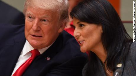 US President Donald Trump and US ambassador to the United Nations Nikki Haley speak during a meeting on United Nations Reform at the United Nations headquarters on September 18, 2017, in New York. (TIMOTHY A. CLARY/AFP/Getty Images)