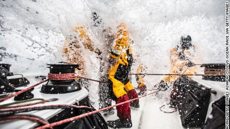 AT SEA - MARCH 24:  In this handout image provided by the Volvo Ocean Race, Leg 5 to Itajai onboard Abu Dhabi Ocean Racing. Louis Sinclair, Daryl Wislang, and Phil Harmer get the fire hydrant at eye level during a gybe in the Southern Ocean. The Volvo Ocean Race 2014-15 is the 12th running of this ocean marathon. Starting from Alicante in Spain on October 04, 2014, the route, spanning some 39,379 nautical miles, visits 11 ports in eleven countries (Spain, South Africa, United Arab Emirates, China, New Zealand, Brazil, United States, Portugal, France, The Netherlands and Sweden) over nine months. The Volvo Ocean Race is the world's premier ocean yacht race for professional racing crews. (Photo by Matt Knighton/Abu Dhabi Ocean Racing/Volvo Ocean Race via Getty Images)