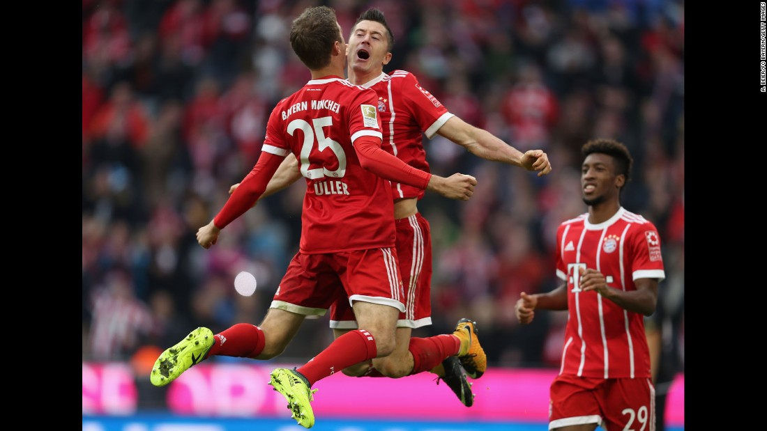 Bayern Munich teammates Thomas Muller, left, and Robert Lewandowski celebrate Muller's opening goal during a German league match against Mainz on Saturday, September 16. Bayern rolled to a 4-0 victory.