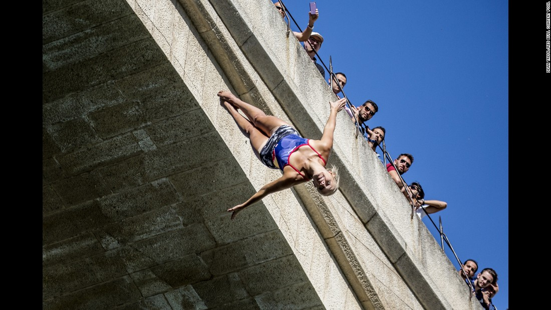 People watch high-diver Rhiannan Iffland train in Mostar, Bosnia-Herzegovina, on Thursday, September 14. Mostar was the latest stop of the Red Bull Cliff Diving World Series.