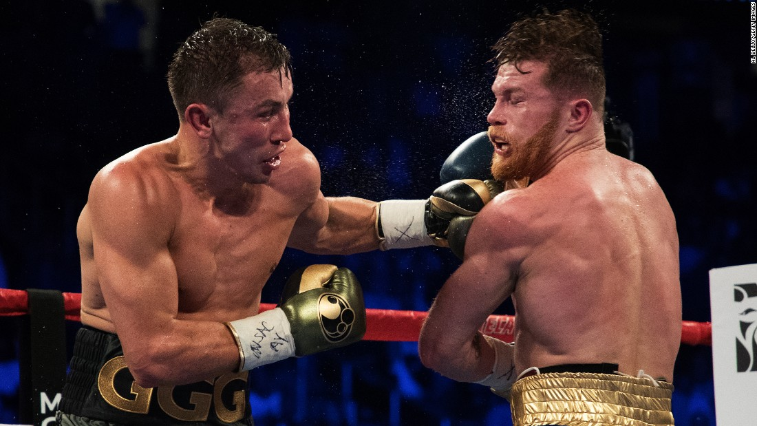 "Gennady Golovkin punches Canelo Alvarez during their middleweight title fight in Las Vegas on Saturday, September 16. The highly anticipated bout <a href=""http://bleacherreport.com/articles/2733795-canelo-alvarez-gennady-golovkin-judge-stood-down-after-controversial-scorecard"" target=""_blank"">ended in a controversial draw.</a>"