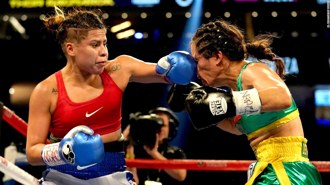 Marlen Esparza punches Aracely Palacios during their flyweight bout in Las Vegas on Saturday, September 16. Esparza won the six-round fight by a unanimous decision.