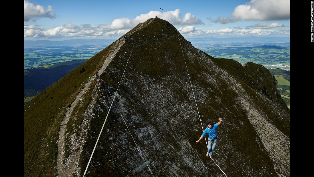 Daniel Laruelle, a slackliner from South Africa, balances near Switzerland's Moleson peak as he competes in the Highline Extreme event on Friday, September 15.