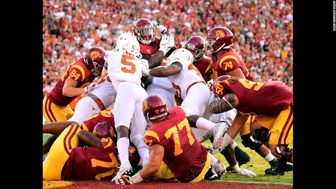 USC running back Ronald Jones II, top, is stuffed at the goal line by Texas defenders on Saturday, September 16. In what was a rematch of the legendary 2006 Rose Bowl, USC escaped with a 27-24 victory in double overtime.