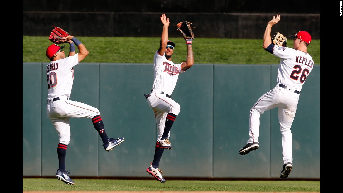 Minnesota outfielders Eddie Rosario, Byron Buxton and Max Kepler mimic basketball players as they celebrate a 13-7 victory over Toronto on Sunday, September 17.