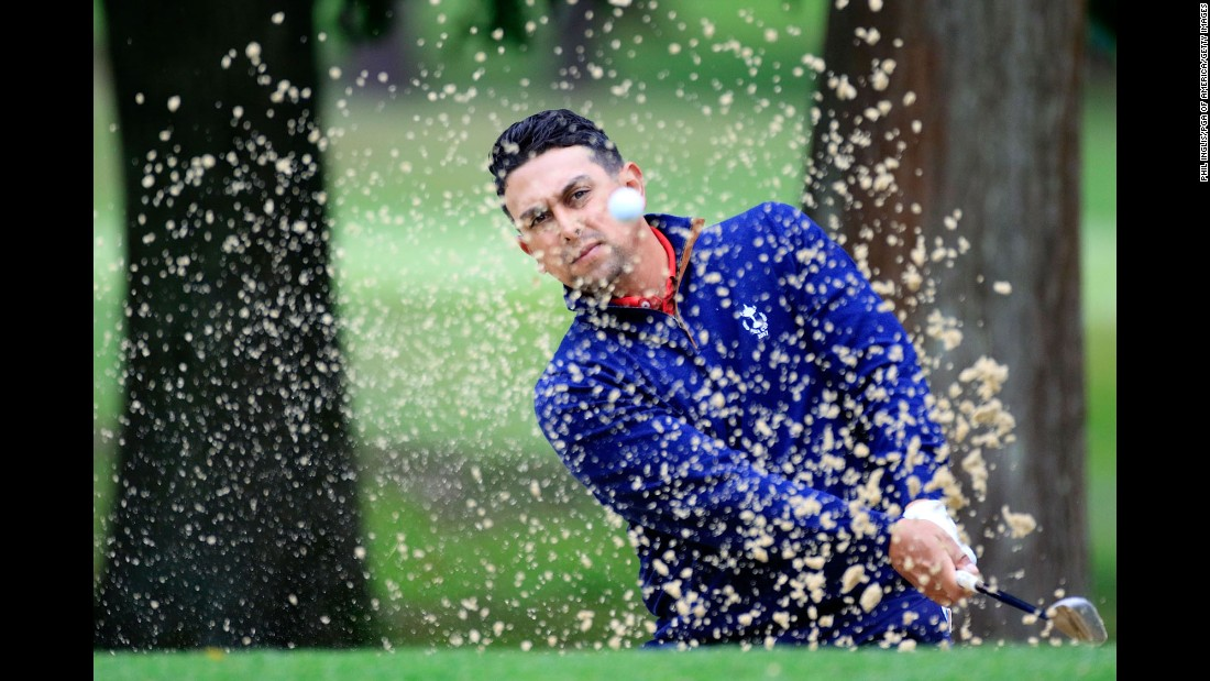 Rich Berberian Jr. hits a shot out of the bunker during the PGA Cup, an international team competition in Ottershaw, England, on Sunday, September 17. Berberian won his singles match, but the US team still lost to the team from Great Britain and Ireland.