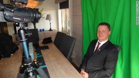 Chris Shortis films videos against a green screen in his home outside Melbourne that he posts to the internet.