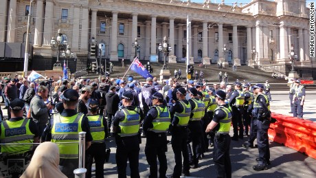 Victoria police officers keep apart rival protests in Melbourne on Sunday, September 17.