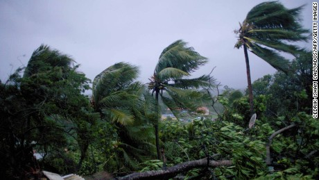 A picture taken on September 19, 2017 shows the powerful winds and rains of hurricane Maria battering the city of Petit-Bourg on the French overseas Caribbean island of Guadeloupe.