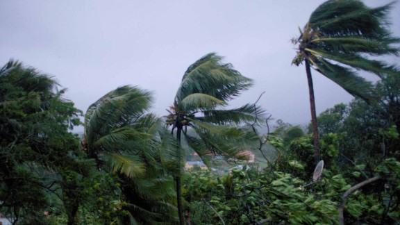"""A picture taken on September 19, 2017 shows the powerful winds and rains of hurricane Maria battering the city of Petit-Bourg on the French overseas Caribbean island of Guadeloupe.Hurricane Maria strengthened into a """"potentially catastrophic"""" Category Five storm as it barrelled into eastern Caribbean islands still reeling from Irma, forcing residents to evacuate in powerful winds and lashing rain. / AFP PHOTO / Cedrik-Isham Calvados /         (Photo credit should read CEDRIK-ISHAM CALVADOS/AFP/Getty Images)"""