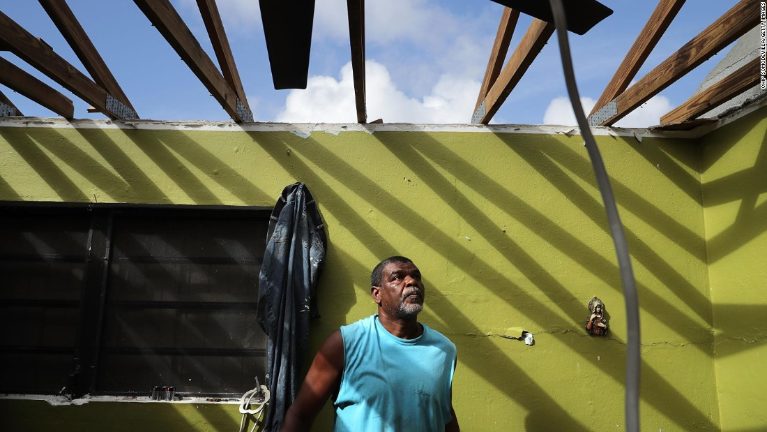 Carmelo Mota, a builder, searches for tools in his destroyed home in Charlotte Amalie, US Virgin Islands, on Monday, September 18. Hurricane Irma devastated the US territory and other Caribbean islands in the region, leaving them exposed to new storms brewing in the Atlantic.