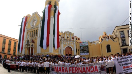 People protest against the murder of Mexican student Mara Castilla, in Xalapa, Veracruz state, Mexico on September 17, 2017. The 19-year-old Castilla was allegedly killed by a taxi driver on September 8, in the southern Mexican state of Puebla. / AFP PHOTO / EDUARDO MURILLO        (Photo credit should read EDUARDO MURILLO/AFP/Getty Images)