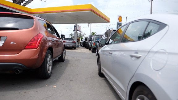 Cars line up at a gas station in San Juan on September 19.