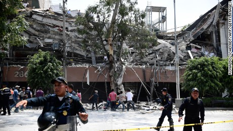 Police officers cordon the area off after a building collapsed during a quake in Mexico City on September 19.