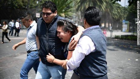 People react as a real quake rattles Mexico City on September 19 moments after an earthquake drill was held in the capital. A 7.1 magnitude earthquake shook Mexico City on the anniversary of a devastating 1985 quake.