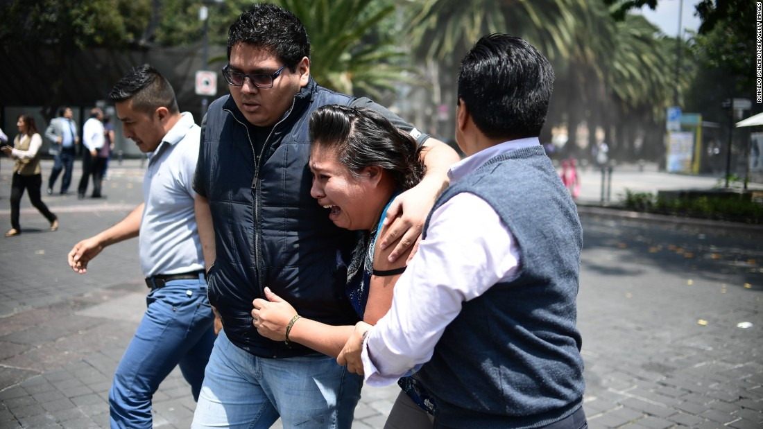 People react in Mexico City just after the quake hit.