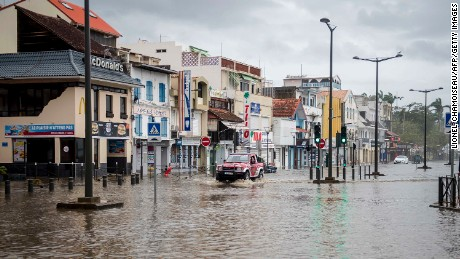A motorist drives on the flooded waterfront in Fort-de-France, on the French Caribbean island of Martinique, after it was hit by Hurricane Maria, on September 19, 2017. Hurricane Maria smashed into the eastern Caribbean island of Dominica on September 19, with its prime minister describing devastating damage as winds and rain from the storm also hit territories still reeling from Irma. Martinique, a French island south of Dominica, suffered power outages but avoided major damage. / AFP PHOTO / Lionel CHAMOISEAU        (Photo credit should read LIONEL CHAMOISEAU/AFP/Getty Images)