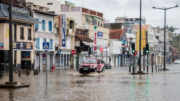 A motorist drives on the flooded waterfront in Fort-de-France, Martinique, on September 19.