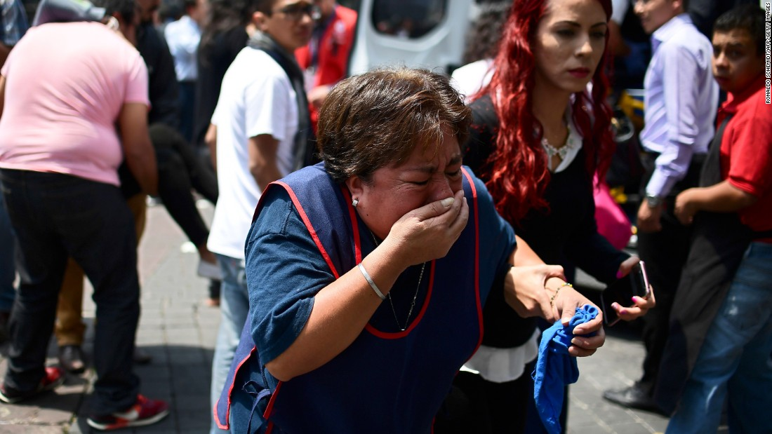 A woman in Mexico City reacts after the quake.