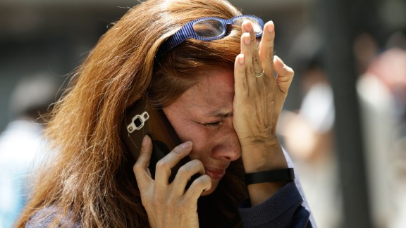 A woman in Mexico City cries as she tries to reach people on her cell phone after the quake.