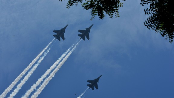 Indian Air Force fighter jets fly past during the cremation ceremony of the Marshal of the Indian Air Force Arjan Singh, in New Delhi on September 18, 2017.