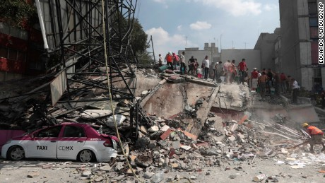 Volunteers search a building that collapsed after an earthquake, in the Roma neighborhood of Mexico City on September 19.