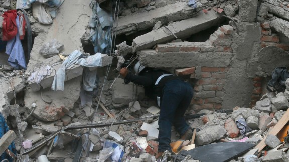 A construction worker searches a building that collapsed after an earthquake in the Roma neighborhood of Mexico City on September 19.