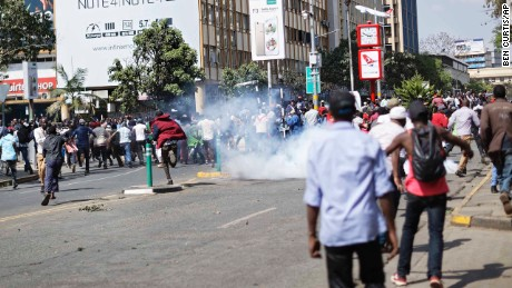 Police fire tear gas at supporters of President Uhuru Kenyatta after they tried to push past a barrier into the court parking lot in Nairobi,  Kenya on Tuesday, September 19.