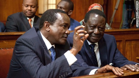 Kenyan opposition presidential candidate, Raila Odinga, right, with his running mate Kalonzo Musyoka, left, attends the Kenyan Supreme Court to hear the detailed ruling concerning the August presidential elections, on Wednesday, September 20.