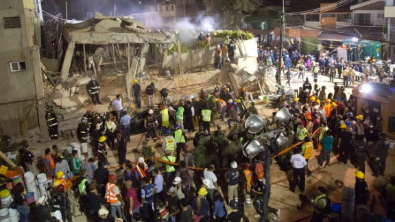 Volunteers and rescue workers search for children trapped inside the collapsed Enrique Rebsamen school in Mexico City on Tuesday.