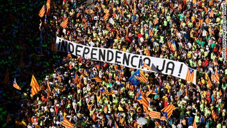 "A banner reads ""Independence now!"" at a rally on September 11, 2017, in Barcelona during National Day celebrations."