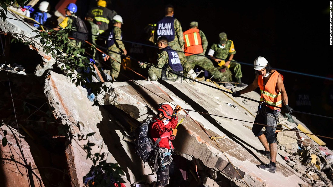 Rescue workers remove rubble from a Mexico City building on September 19.
