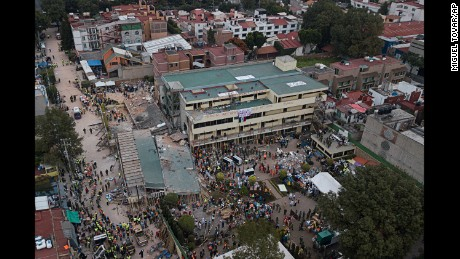 Mexico City crews race to save girl trapped in school rubble