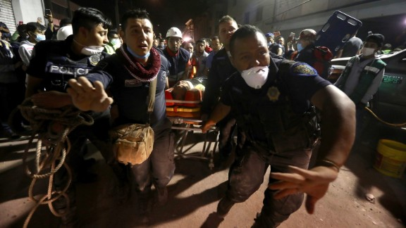 An injured person is carried away after being rescued in Mexico City on Tuesday, September 19. The earthquake happened on the anniversary of a 1985 quake that killed an estimated 9,500 people in and around Mexico City.