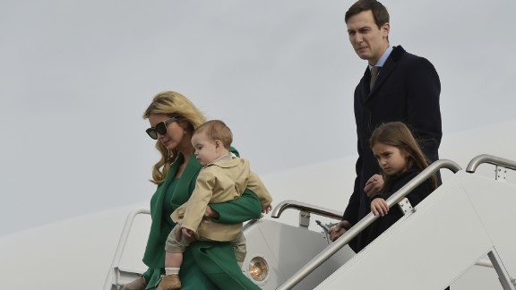 TOPSHOT - US President-elect Donald Trump's daughter Ivanka Trump, her son, her husband Jared Kushner and daughter Arabella, step off a plane upon arrival at Andrews Air Force Base in Maryland on January 19, 2017.  / AFP / MANDEL NGAN        (Photo credit should read MANDEL NGAN/AFP/Getty Images)