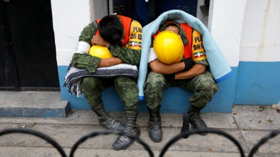 Members of the Mexican Army nap September 20 after assisting in search-and-rescue missions in Mexico City.