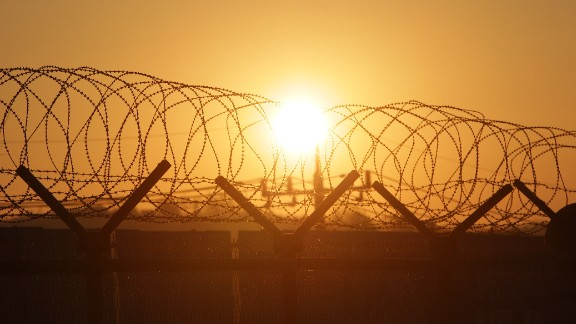 PAJU, SOUTH KOREA - JANUARY 08: A sunrise is seen through a barbed-wire fence at the Imjingak, near the Demilitarized zone (DMZ) separating South and North Korea on January 8, 2016 in Paju, South Korea. South Korea announced on January 7th that it would resume the broadcasts from loudspeakers placed along the border, criticizing the North in response to its nuclear test. In August, 2015, when South Korean soldiers were maimed by land mines in the DMZ, South Korea started the loudspeaker broadcasts and the North threatened to attack the speakers. (Photo by Chung Sung-Jun/Getty Images)