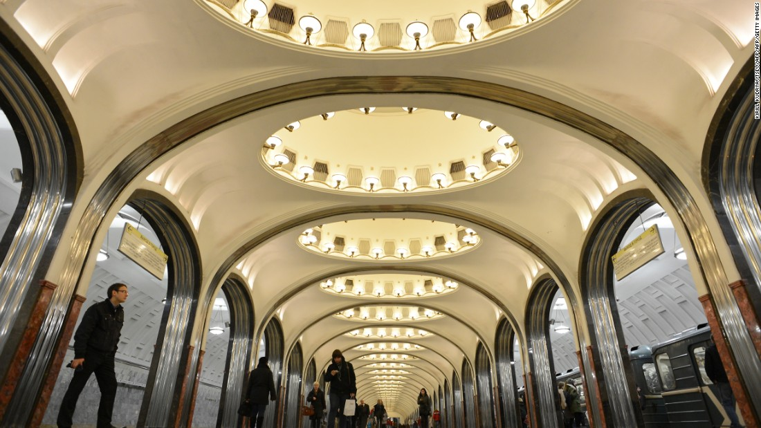 Subway passengers walk through Mayakovskaya  station in Moscow.