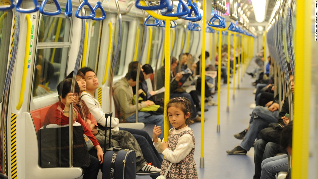 Passengers on a Mass Transit Rail (MTR) train in Hong Kong.