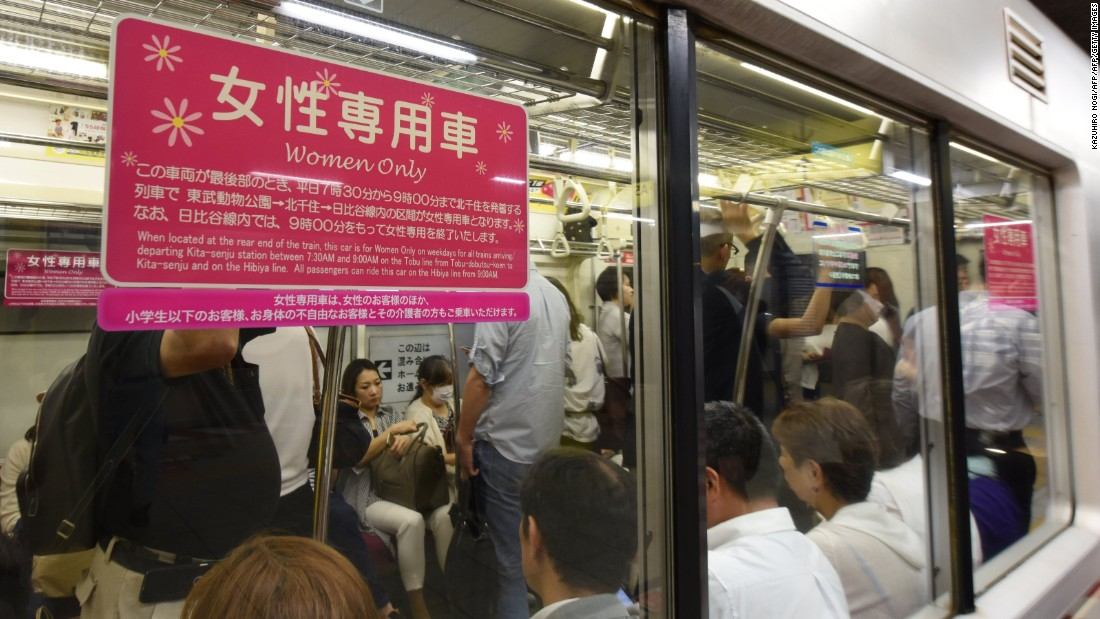 A poster informing commuters of a women's-only carriage is displayed on a subway train in Tokyo on June 2, 2017.